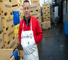 In this photo taken October 28, 2019, fishmonger Kristjan Asgeirsson is seen at work in Reykjavik, Iceland. Asgeirsson lost $68,000 in an online scam. (AP Photo/Egill Bjarnason)
