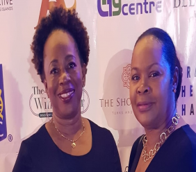 Permanent Secretary for Tourism Cherylann Jones (l) and Permanent Secretary for Home Affairs, Transportation and Communication Clara Gardiner at the TCIFF.