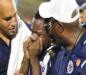 Omar Thompson (centre), captain of Jamaica College (JC), sheds tears of joy after the Dark Blues beat Kingston College (KC) on penalties to win the second semi-final match of the ISSA/Digicel Manning Cup football competition at the National Stadium on Wednesday, November 20, 2019. (PHOTOS: Marlon Reid).