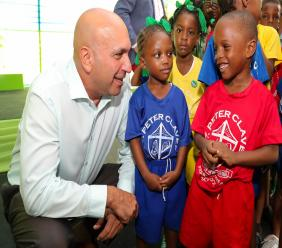 Christopher Zacca, President & CEO, Sagicor Group Jamaica, has an engaging conversation with children from the Sagicor Foundation adopted schools, at the launch of the Foundation's 2019/2020 Adopt-a-School programme at Hope Zoo last week.