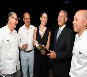 Diana Thorburn shares a few pages of her new book with her husband, Wayne Chen (Chairman of SRHA), R. Danny Williams (Sagicor Foundation Chairman), Former Prime Minister Bruce Golding and Jeffrey Hall (CEO of Jamaica Producers Group).