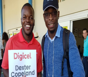 Digicel Marketing Executive Romello Williams greeting Guyanese winner Dexter Copeland as he arrived in the Turks and Caicos on Friday for the Turks and Caicos International Film Festival.