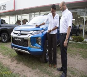 Duncan Stewart, Director at Stewart's Automotive Group, checks out the new 2020 Mitsubishi L200 at the 49 ½ South Camp Road location with Mitsubishi Brand Manager, Maria Phillpotts.