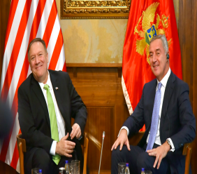 In this photo taken October 4, 2019, United States Secretary of State Mike Pompeo, left, speaks with Montenegro President Milo Djukanovic, in Podgorica, Montenegro. (AP Photo/Risto Bozovic)