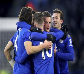 Leicester City's Jamie Vardy, 2nd right, celebrates after Norwich City goalkeeper Tim Krul scored an own goal, during their English Premier League football match at King Power Stadium in Leicester, England, Saturday Dec. 14, 2019. (Nick Potts/PA via AP).
