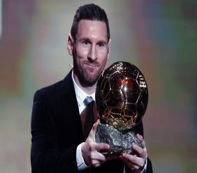 Barcelona's football player Lionel Messi holds the trophy of the Golden Ball award ceremony in Paris, Monday, Dec. 2, 2019. Messi won the Ballon d'Or for sixth time. (AP Photo/Francois Mori)