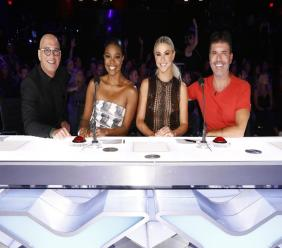 "This image released by NBC shows celebrity judges, from left, Howie Mandel, Gabrielle Union, Julianne Hough, Simon Cowell on the set of ""America's Got Talent,"" in Los Angeles. (Trae Patton/NBC via AP)"