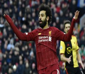 Liverpool's Mohamed Salah gestures during the English Premier League football match against Watford at Anfield stadium in Liverpool, England, Saturday, Dec. 14, 2019. (AP Photo/Rui Vieira).