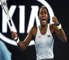 "United States' Cori ""Coco"" Gauff reacts during her first round singles match against compatriot Venus Williams at the Australian Open tennis championship in Melbourne, Australia, Monday, January 20, 2020. (AP Photo/Dita Alangkara)"