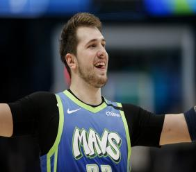 Dallas Mavericks forward Luka Doncic celebrates during a timeout in the second half of the team's NBA basketball game against the Portland Trail Blazers, Friday, Jan. 17, 2020, in Dallas. The Mavericks won 120-112. (AP Photo/Brandon Wade).