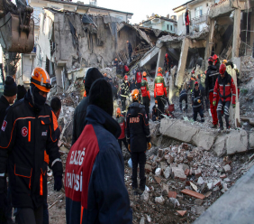 Rescue workers try to save people trapped under debris following a strong earthquake that destroyed several buildings on Friday, in Elazig, eastern Turkey, Sunday, January 26, 2020. (Ismail Coskun/IHA via AP)