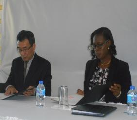 His Excellency Ambassador Tatsuo Hirayama and Acting Principal of the Piaye Combined School sign the agreement