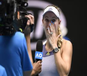 Denmark's Caroline Wozniacki wipes away tears after a third round loss to Tunisia's Ons Jabeur at the Australian Open tennis championship in Melbourne, Australia, Friday, Jan. 24, 2020. (AP Photo/Andy Brownbill).