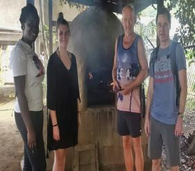 TTAL Marketing Officer Ms. Andra Joefield (left) with the participating journalists in the recent fam trip at a dirt oven in Castara. (Photo via the Tobago Tourism Agency)