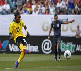 Reggae Boy striker Darren Mattocks kicks a penalty in a Gold Cup match.