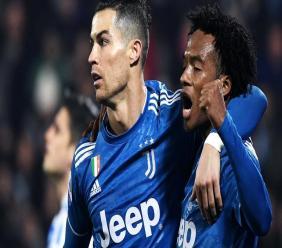 Cuadrado congratule Ronaldo après son ouverture du score. | AFP