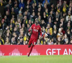 Liverpool's Sadio Mane celebrates after scoring  during the English Premier League football match against Norwich City at Carrow Road Stadium in Norwich, England, Saturday, Feb. 15, 2020. (AP Photo/Frank Augstein).