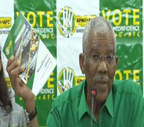 President David Granger holding a copy of the APNU+AFC 2020 Regional and General Election manifesto