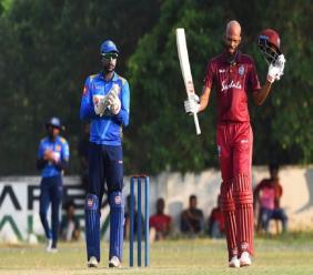 Roston Chase celebrates his century against the the Sri Lanka Board President's XI.