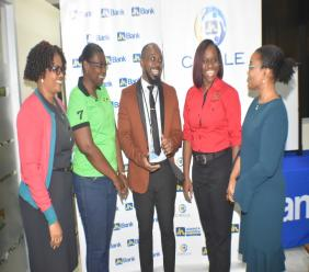 Claudine Allen(right), Member Ombudsman, The Jamaica National Group and Sophia Allen-Peart (left), operations support officer, JN Bank Port Antonio branch congratulate the executive of the JN Circle Port Antonio. From second left are: Nadine Simpson McLean, treasurer; Ryan Bailey, president and Kerri-Ann Harris, secretary.