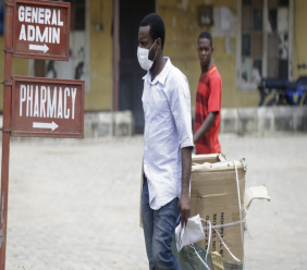 A man wearing face mask walks at the Yaba Mainland hospital were the first Nigerian victims of the COVID-19 virus are being treated in Lagos Nigeria Friday, Feb. 28, 2020. Nigeria's health authorities have reported the country's first case of a new coronavirus in Lagos, the first confirmed appearance of the disease in sub-Saharan Africa. (Photo/ Sunday Alamba)