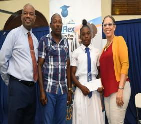 Yvonne Ennis (right) of Communityand Workers of Jamaica(C&WJ)Co-operative Credit Union poses with Hydel High sprint hurdler Oneika Wilson (2nd right),  the outstanding athlete of the 2020 McKenley/Wint Track& Field Classics, after presenting the athlete with a cheque for $25,000. At left is Albert Corocho, principal of Calabar High School, which hosted the meet and John Mair, one of  coaches at Hydel.
