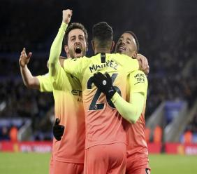 Manchester City's Gabriel Jesus, right, celebrates his goal against Leicester with team mates Riyad Mahrez, centre, and Mota Bernardo Silva during their English Premier League football match at the King Power Stadium in Leicester, England, Saturday Feb. 22, 2020. (Nick Potts/PA via AP).
