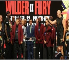 Deontay Wilder (left) and Tyson Fury (right) at the weighing session on Friday.