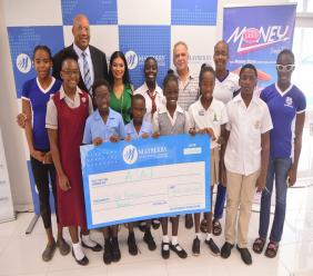 Cedric Stewart (back row, 2nd left), Sales Manager at  Mayberry Investments Limited; Dionne Marie Harris (back row, 3rd left), Digital Marketing Manager at Mayberry Investments Limited and Martin Lyn (back row, 5th left), Aquatic Sports Association of Jamaica president, pose with student athletes following a cheque presentation at the launch of the 22nd staging of theMayberryInvestments swim meet at the National Aquatic Centre on Thursday, February 27, 2020.