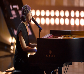 "In this March 14, 2019 file photo, Alicia Keys performs ""Raise A Man,"" at the iHeartRadio Music Awards at the Microsoft Theater in Los Angeles. Keys sang softly from the piano, from her home, on March 29, 2020 to kick off the hour-long ""living room"" benefit concert put on to raise money during the coronavirus crisis. (Photo by Chris Pizzello/Invision/AP, File)"