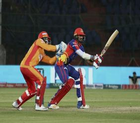 Karachi Kings batsman Umaid Asif, right, plays a shot during a Pakistan Super League T20 cricket match against Islamabad United at the National Stadium in Karachi, Pakistan, Saturday, March 14, 2020. (AP Photo/Fareed Khan).
