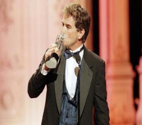 "In this Friday, Feb. 27, 1998 file photo, John Callahan of ""All My Children"" kisses his award after winning Outstanding Lead Actor at the Soap Opera Digest Awards. (AP Photo/Rene Macura)"
