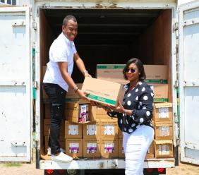 Member of Parliament for St Andrew East Rural, Juliet Holness  (right ) accepts a donation from Nestle Garfene Grandison,General Manager atNestle Jamaica Health and Wellness Foundation for residents of Bull Bay in eastern St Andrew.