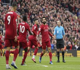 Liverpool players celebrating. The English Premier League was paused more than three weeks ago with Liverpool leading by 25 points with nine game games.