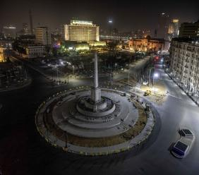 A general view shows Tahrir Square, which was the focal point of the January 25, 2011 Egyptian uprising that toppled autocrat Hosni Mubarak, closed off by police during curfew hours as a prevention measures due to the coronavirus outbreak, in Cairo, Egypt on March 29, 2020. (AP Photo/Nariman El-Mofty)