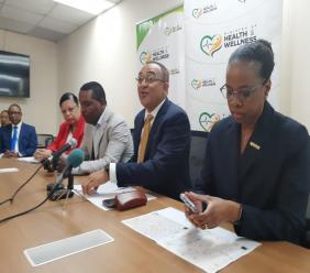 File photo of Dr Christopher Tufton and other health officials addressing journalists at a press conference.