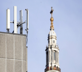 FILE - In this Tuesday, Jan 28, 2020 file photo, mobile network phone masts are visible in front of St Paul's Cathedral in the City of London.  (AP Photo/Alastair Grant, File)