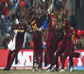 Carlos Brathwaite is mobbed by team-mates after his heroics sunk England.