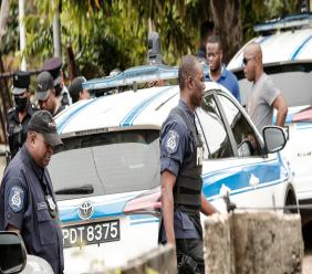 Police officers on patrol in Arima during an anti-crime exercise.