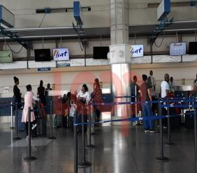 Passengers checking-in at the Liat counter at GAIA in Barbados (FILE)