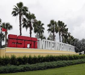 A sign marking the entrance to ESPN's Wide World of Sports at Walt Disney World is seen Wednesday, June 3, 2020, in Kissimmee, Fla.  A 22-team format for restarting the NBA season in late July will take place at the Disney campus. (AP Photo/John Raoux).