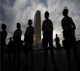 Police stand guard as protesters rally at the Trump Tower, Monday, June 1, 2020, in Las Vegas, over the death of George Floyd. Floyd, a black man, died after being restrained by Minneapolis police officers on Memorial Day. (AP Photo/John Locher)