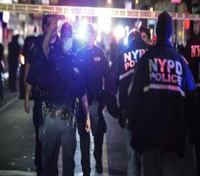 New York City police officers work a scene early Thursday, June 4, 2020, in the Brooklyn borough of New York. The police department says a police officer has been shot in Brooklyn. (AP Photo/Frank Franklin II)