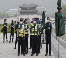 Police officers wearing face masks to help protect against the spread of the new coronavirus stand guard near the US embassy in Seoul, South Korea, Friday, June 5, 2020. (AP Photo/Ahn Young-joon)