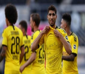 Borussia Dortmund's Achraf Hakimi  celebrated his goal against Paderborn in the Bundesliga on Sunday by displaying the message 'Justice for George Floyd'.