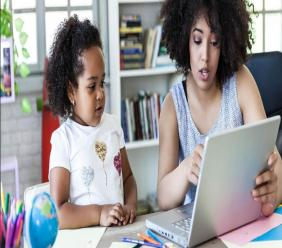 Mum helping daughter with homeschooling (Internet image: texashomelearning.org)
