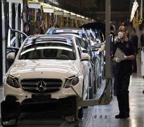 Workers inspect newly assembled cars at a Beijing Benz Automotive Co. Ltd factory, a German joint venture company for Mercedes-Benz, in Beijing on Wednesday, May 13, 2020. Chinese media reported Sunday, July 5, 2020 that Mercedes-Benz will recall more than 660,000 vehicles in China later this year for a possible oil leak with most of the vehicles being manufactured by Beijing Benz Automotive Co. (AP Photo/Ng Han Guan)