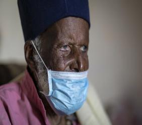 Centenarian Tilahun Woldemichael cries at his house in Addis Ababa, Ethiopia. This he does as he prays to God after spending weeks in hospital, recovering from the coronavirus. (AP photo)