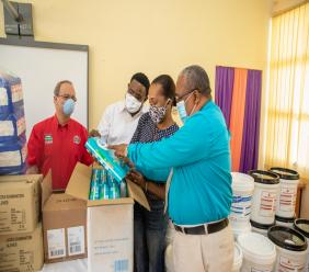 From left to right) RUBiS Energy Jamaica Limited's CEO, Alain Carreau and Human Resource Manager Donnovan Dobson look on as Bellevue Hospital's Occupational Therapy Manager, Jhnell Reid-Bowen and Director, Nursing Services, Devon Williams open the contents of items donated by RUBiS to the Kingston-based psychiatric facility on Friday, June 26, 2020.