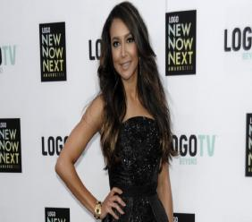 FILE - In this April 1,3 2013, file photo, actress Naya Rivera arrives at Logo's NewNowNext Awards in Los Angeles. A member of a team searching a Southern California lake for Rivera, the missing TV star, said Sunday, July 12, that he's confident his crew is getting a clearer idea of where in the lake to find her, a magazine reported.  (Photo by Dan Steinberg/Invision/AP, File)